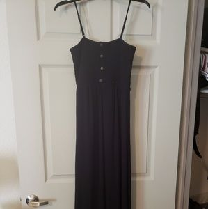 Maxi black dress with brown buttons